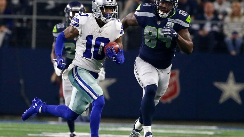 5d8f5be0742 5, 2019, file photo, Dallas Cowboys' Tavon Austin (10) returns a punt for a  long gain as Seattle Seahawks' Ed Dickson gives chase during an NFC  wild-card ...